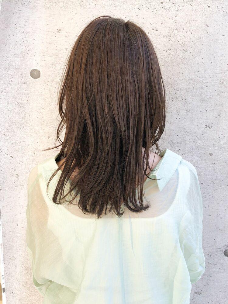 ひし形シルエットのゆるやかウェーブに春らしい透明感カラーのトレンドスタイル