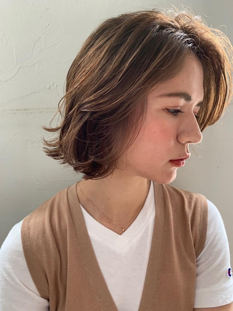joemi by unami/新宿駅直結 土井陸表面から出るミックスパーマボブ×オレンジュ