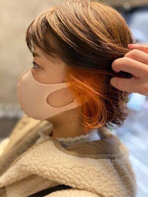 ショートヘアから、ボブにチェンジ。イヤリングカラーはオレンジ。